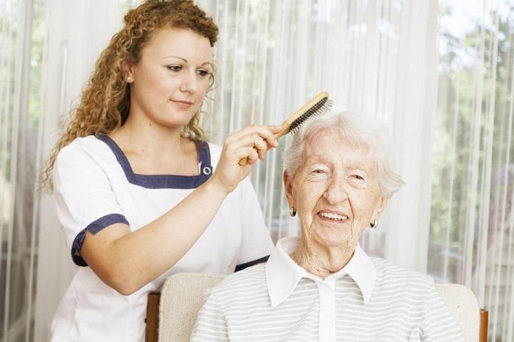 kind care hair brushing for senior woman